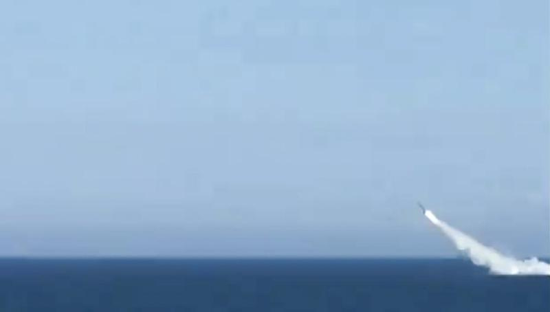 A cruise missile is launched from a submarine during Russian navy drills