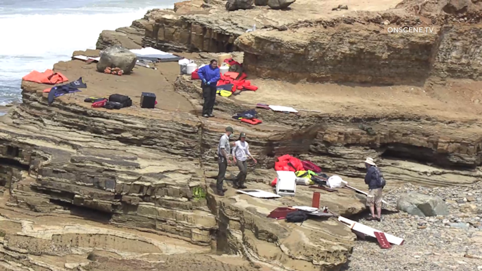 Items from a boat sit on a cliff at Cabrillo National Monument near where it capsized just off the San Diego coast on Sunday, May 2, 2021. / Credit: OnScene.TV