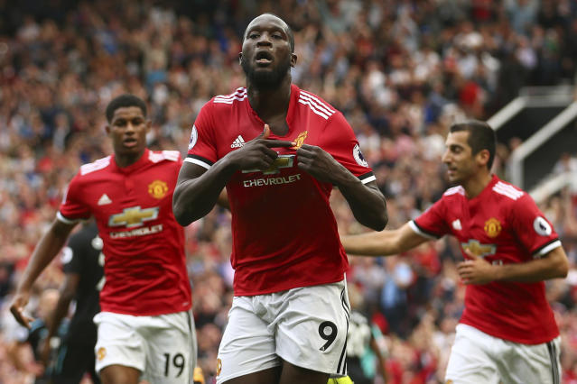 Romelu Lukaku celebrates scoring on his Manchester United debut. (AP Photo/Dave Thompson)