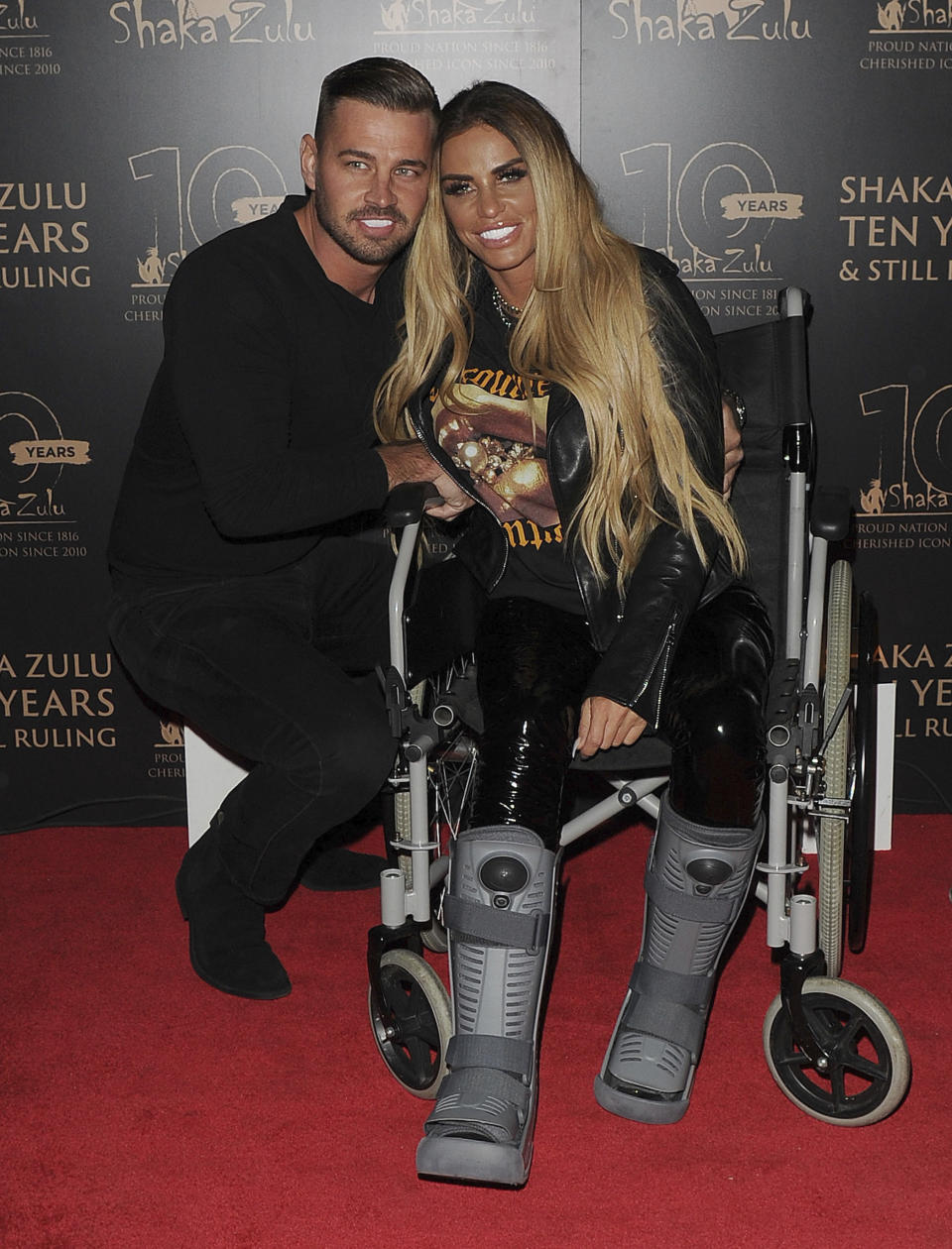 Photo by: zz/KGC-305/STAR MAX/IPx 2020 9/10/20 Katie Price and her boyfriend Carl Woods at the 10th Anniversary Celebration for Shaka Zulu Restaurant held on September 10, 2020 in Camden. Katie is confined to a wheelchair after suffering two broken ankles in an accidental fall from a 25 foot wall at a theme park while on holiday in Turkey earlier in the summer. (London, England, UK)