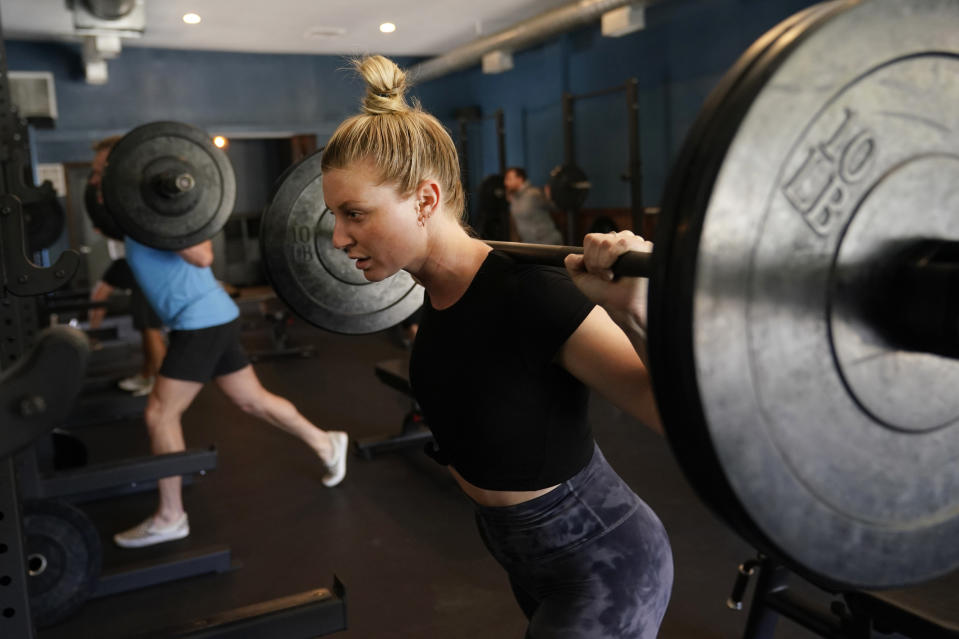 Claire Wilcox participates in a fitness class at Lift Society Friday, May 21, 2021, in Studio City, Calif. California's top health official says the state no longer will require social distancing and will allow full capacity for businesses when the state reopens on June 15. (AP Photo/Marcio Jose Sanchez)