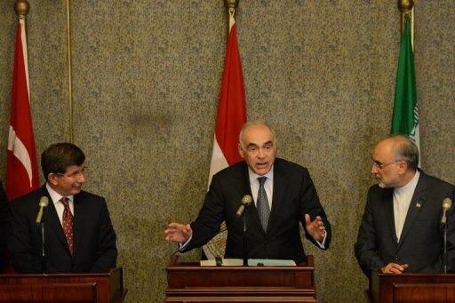 Egyptian Foreign Minister Mohammed Kamel Amr (centre) is flanked by Iranian and Turkish counterparts in Cairo