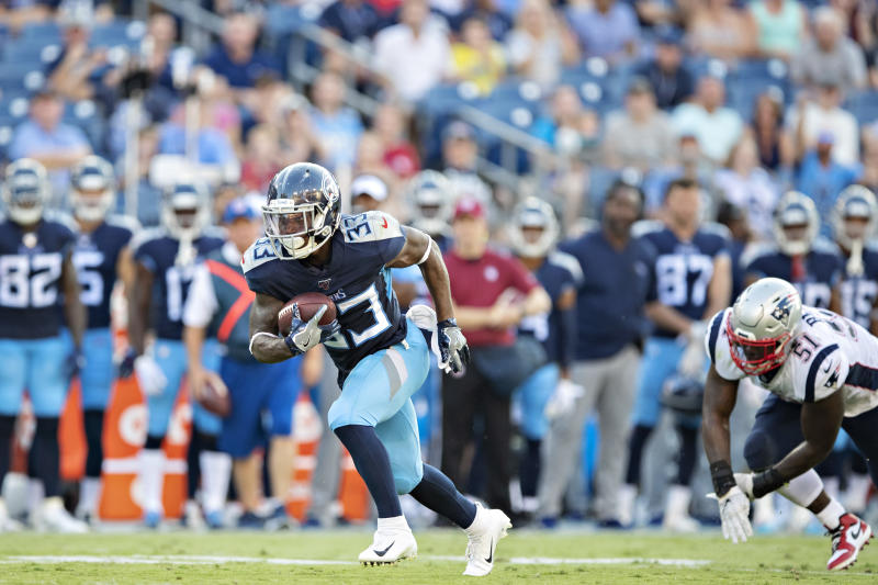 NASHVILLE, TN - AUGUST 17: Dion Lewis #33 of the Tennessee Titans runs the ball during a game against the New England Patriots during week two of the preseason at Nissan Stadium on August 17, 2019 in Nashville, Tennessee. The Patriots defeated the Titans 22-17. (Photo by Wesley Hitt/Getty Images)
