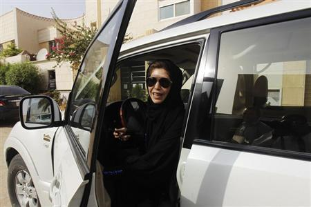 Female driver Azza Al Shmasani alights from her car after driving in defiance of the ban in Riyadh