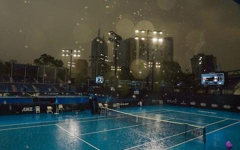 heavy rain falls during an Australian Open practice session at Melbourne Park in Melbourne, Australia, 15 January 2020. - Credit: SCOTT BARBOUR/EPA-EFE/REX