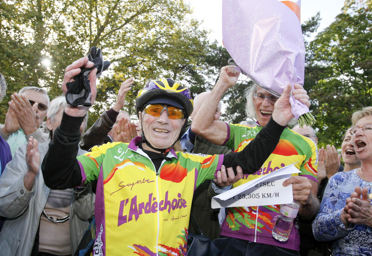 French centenarian Robert Marchand reacts after he set a record for the fastest 100-year-old to cover 100km (62 miles) at the outdoor Tete-d'Or Velodrome track in Lyon September 28, 2012. Marchand, who turns 101 on November 26, has been training every day for months in hopes of crossing the finish line in less than five hours. Marchand cycled 100km in 4 hours 17 minutes and 27 seconds with an average speed of 23.305 km per hour.   REUTERS/Robert Pratta (FRANCE - Tags: SPORT CYCLING SOCIETY)