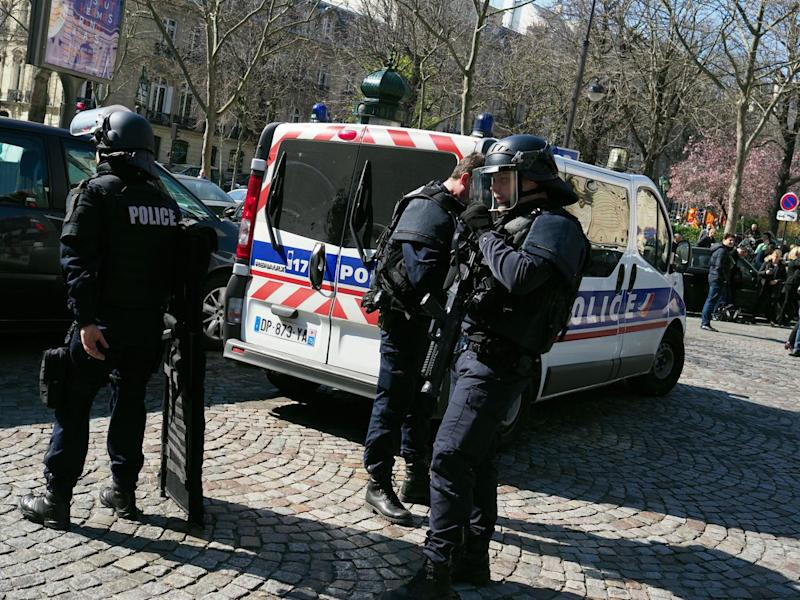 French police officers take position after a parcel bomb exploded at the French office of the International Monetary Fund in Paris on 16 March (AP)