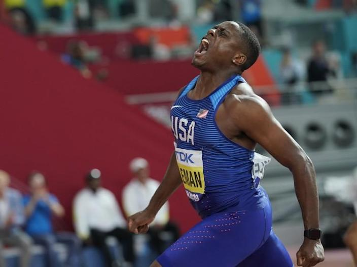 FILE - In this file photo dated Saturday, Sept. 28, 2019, Christian Coleman, of the United States, celebrates winning the gold medal in Doha, Qatar. Men's 100-meter world champion Christian Coleman has been banned for two years until May 2022, for missing three doping control tests, according to officials Tuesday Oct. 27, 2020. (AP Photo/David J. Phillip, FILE)