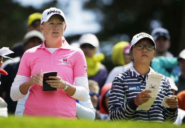 Stacy Lewis, left, and Lydia Ko, right, of New Zealand prepare to hit from the third tee of the Lake Merced Golf Club during the third round of the Swinging Skirts LPGA Classic golf tournament on Saturday, April 26, 2014, in Daly City, Calif. (AP Photo/Eric Risberg)