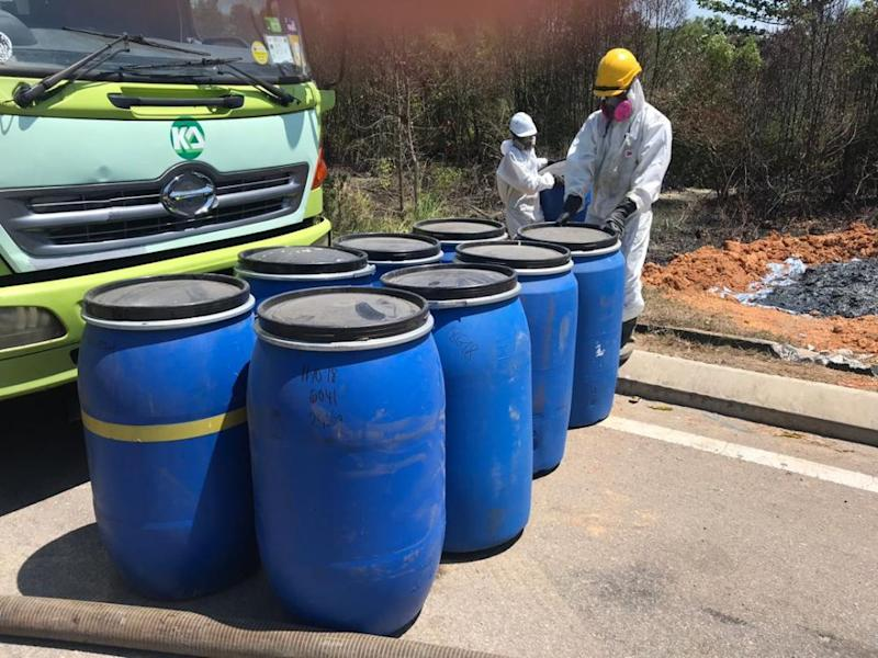 More than 15 barrels, believed to contain chemical waste, were found and removed by workers Sungai Masai adjacent to the Pasir Gudang-Johor Baru Highway today. ― Picture via social media