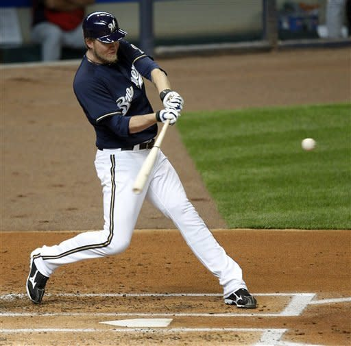 Milwaukee Brewers' Corey Hart hits a home run against the St. Louis Cardinals during the second inning of a baseball game, Saturday, April 7, 2012, in Milwaukee. (AP Photo/Jeffrey Phelps)