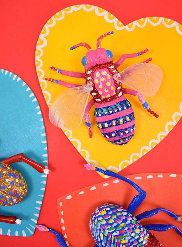"""<p>Your kids can get creative painting these creepy crawly creatures that they can keep or give to their friends. </p><p><strong>Get the tutorial at <a href=""""https://www.dreamalittlebigger.com/post/love-bug-valentine-toys-on-display.html"""" rel=""""nofollow noopener"""" target=""""_blank"""" data-ylk=""""slk:Dream a Little Bigger"""" class=""""link rapid-noclick-resp"""">Dream a Little Bigger</a>.</strong></p><p><strong><a class=""""link rapid-noclick-resp"""" href=""""https://www.amazon.com/Zenacolor-Tube-Acrylic-Paint-Tubes/dp/B01N15FIQC/?tag=syn-yahoo-20&ascsubtag=%5Bartid%7C10050.g.1584%5Bsrc%7Cyahoo-us"""" rel=""""nofollow noopener"""" target=""""_blank"""" data-ylk=""""slk:SHOP PAINTS"""">SHOP PAINTS</a><br></strong></p>"""
