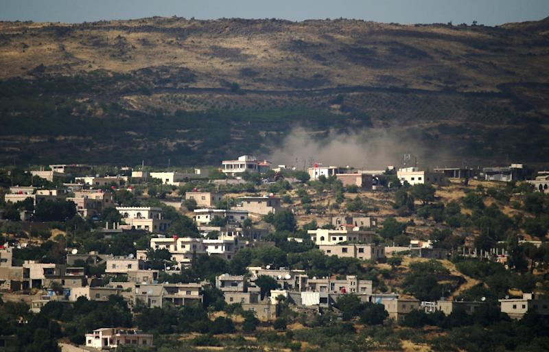 A picture taken from Golan Heights shows smoke rising in the Syrian Druze village of Hadar on June 20, 2015, following Syrian army airstrikes against opposition rebel fighters (AFP Photo/Jalaa Marey)