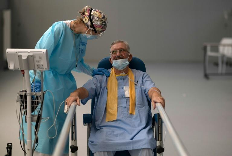 COVID-19 patients like Jesus Nogales (Right) receive assistance at a rehabilitation centre in Spain