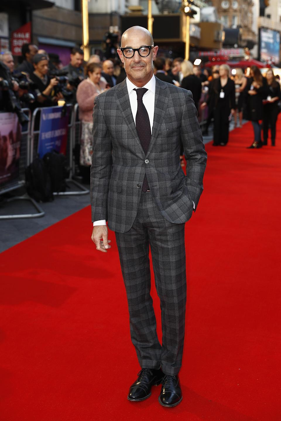 <p>Stanley cut a sharp figure in a grey, check suit by Corneliani for the European premiere of 'A Private War'. <em>[Photo: Getty]</em> </p>