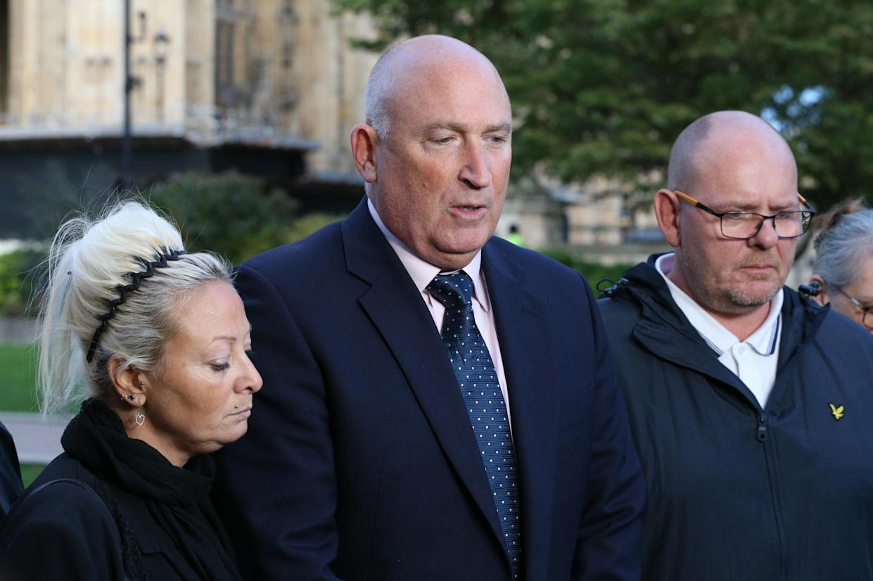 Spokesman Radd Seiger for the family of Harry Dunn, flanked by mother Charlotte Charles and father Tim Dunn, speaking after their meeting with Dominic Raab (PA)