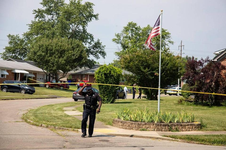 A police officer crossed under a police tape on Thirlstane Court in Lexington Wednesday.
