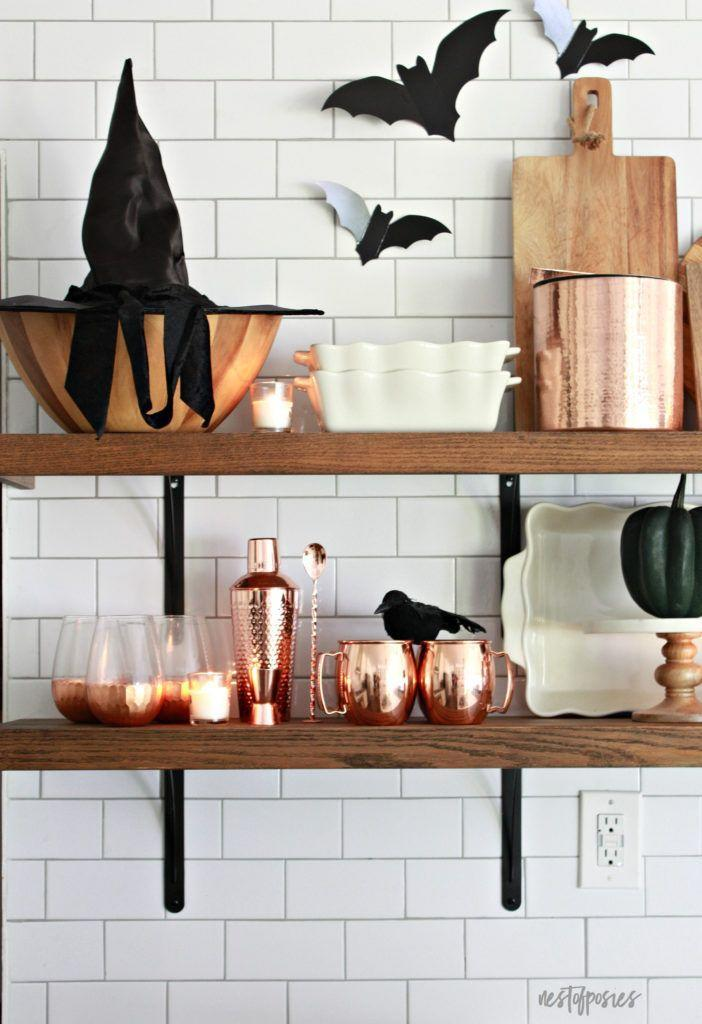"""<p>A few adds — bats, crows, pumpkins, and a witch's hat — make everyday bowls and cutting boards look sorta spooky. </p><p><em><a href=""""https://www.nestofposies-blog.com/2018/10/batulous-halloween-home-tour/"""" rel=""""nofollow noopener"""" target=""""_blank"""" data-ylk=""""slk:Get the tutorial at Nest of Posies »"""" class=""""link rapid-noclick-resp"""">Get the tutorial at Nest of Posies »</a></em> </p>"""