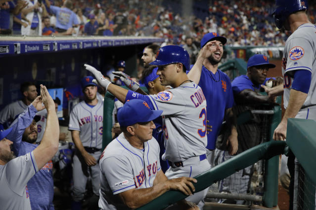 New York Mets' Michael Conforto, center, celebrates a home run off of Philadelphia Phillies relief pitcher Edgar Garcia during the ninth inning of a baseball game, Friday, Aug. 30, 2019, in Philadelphia. (AP Photo/Matt Rourke)