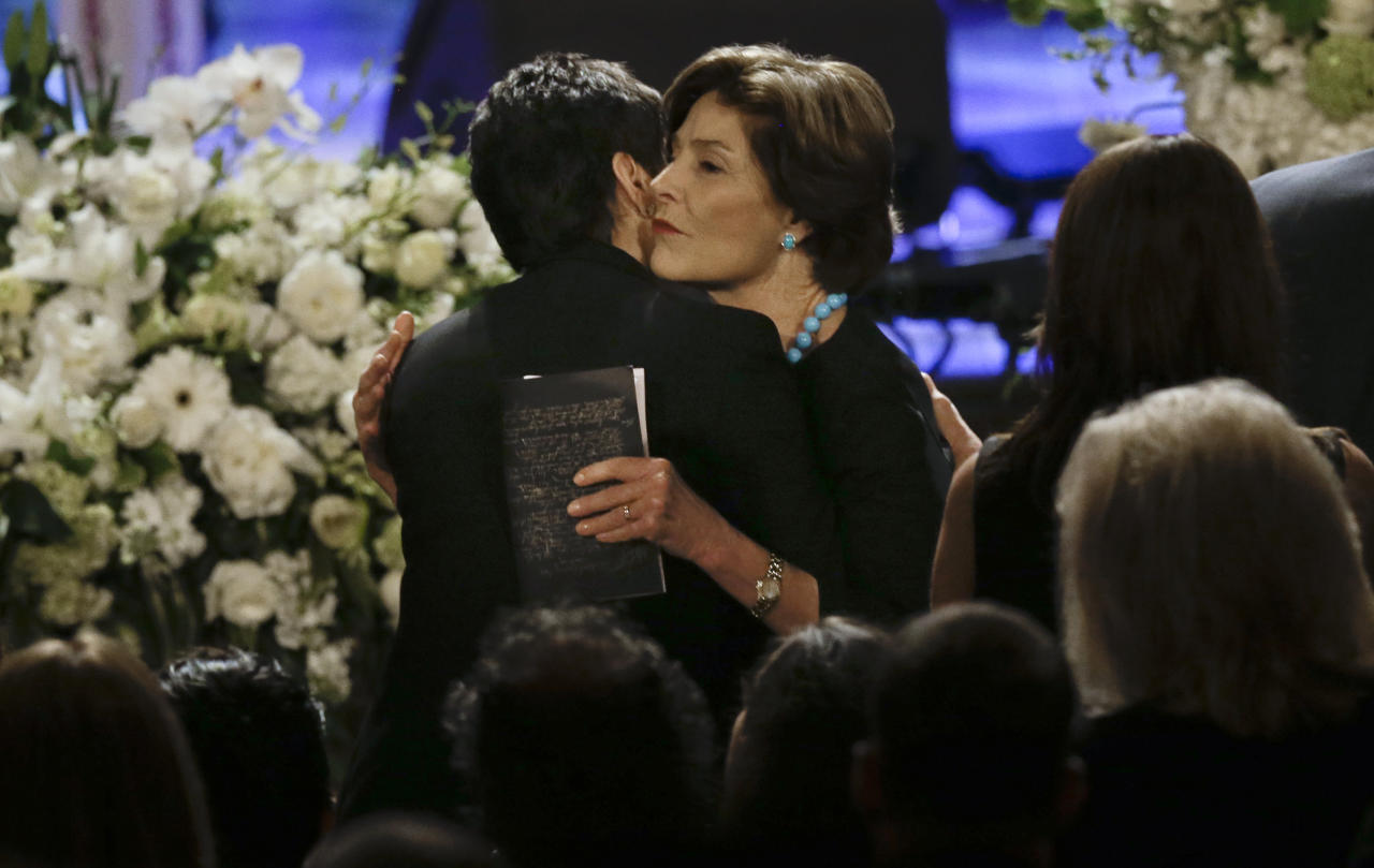 Former first lady Laura Bush hugs Nancy Jones, left, the widow of country music star George Jones during the funeral for George Jones in the Grand Ole Opry House on Thursday, May 2, 2013, in Nashville, Tenn. Jones, one of country music's biggest stars who had No. 1 hits in four separate decades, died April 26. (AP Photo/Mark Humphrey, Pool)