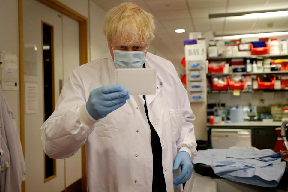 U.K. Prime Minister Boris Johnson during a visit to the Jenner Institute in Oxford where he met scientists who are leading the vaccine research. (ASSOCIATED PRESS)