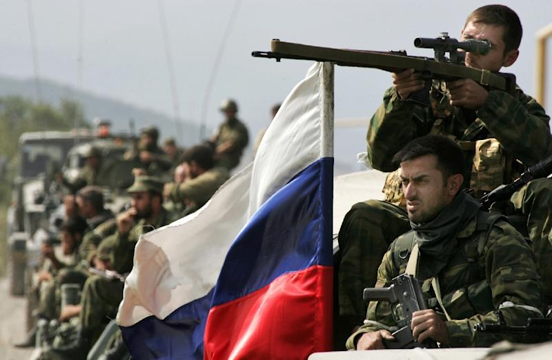 Russian troops enter a South Ossetian village in August 2008 during the lightning war with Georgia