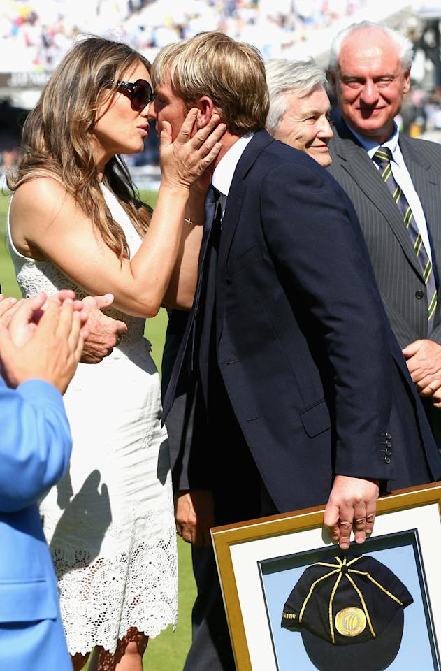 LONDON, ENGLAND - JULY 19: Shane Warne is congratulated by his fiance Elizabeth Hurley after he was inducted into the ICC Cricket Hall of Fame during day two of the 2nd Investec Ashes Test match between England and Australia at Lord's Cricket Ground on July 19, 2013 in London, England. (Photo by Ryan Pierse/Getty Images)
