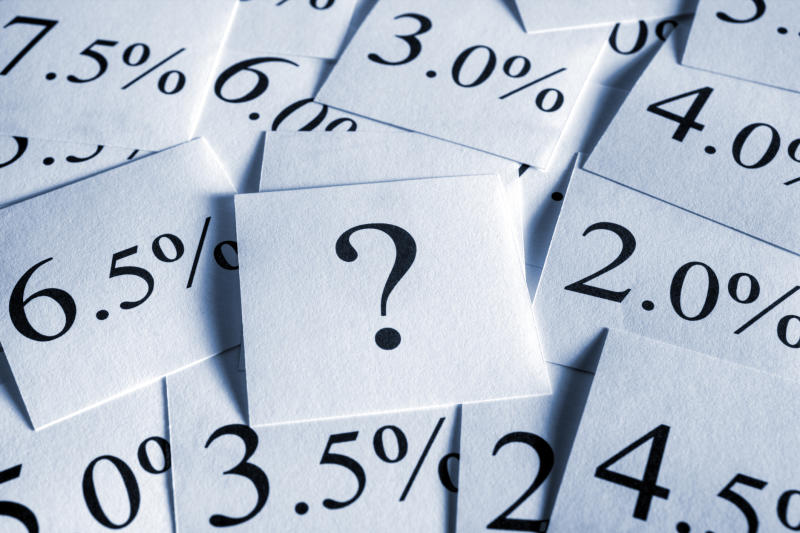 Interest rates and a question mark scattered about on flash cards.