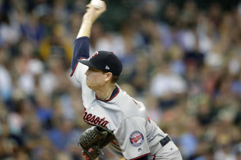 Minnesota Twins starting pitcher Kyle Gibson throws against the Milwaukee Brewers during the first inning of a baseball game Wednesday, Aug. 14, 2019, in Milwaukee. (AP Photo/Jeffrey Phelps)