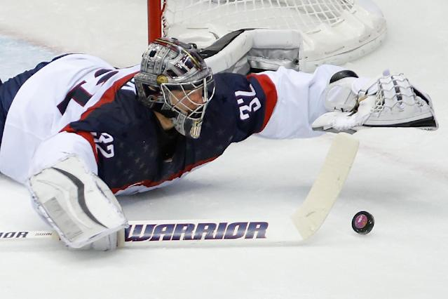 USA goaltender Jonathan Quick dives for the puck during the second period of the men's semifinal ice hockey game at the 2014 Winter Olympics, Friday, Feb. 21, 2014, in Sochi, Russia. (AP Photo/Mark Humphrey)