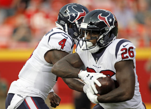 Houston Texans quarterback Deshaun Watson (4) hands the ball off to running back Lamar Miller (26) during the first half of the team's NFL preseason football game against the Kansas City Chiefs in Kansas City, Mo., Thursday, Aug. 9, 2018. (AP Photo/Colin E. Braley)