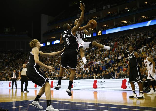 Alan Anderson (6) of the Brooklyn Nets tries to block Jeff Teague of the Atlanta Hawks during their NBA basketball game at the O2 in London, January 16, 2014. REUTERS/Andrew Winning (BRITAIN - Tags: SPORT BASKETBALL TPX IMAGES OF THE DAY)