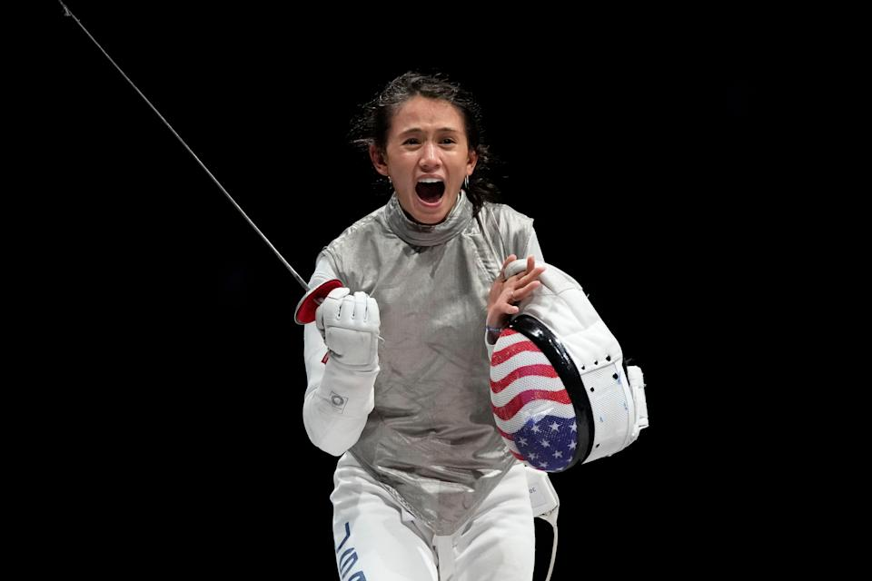Lee Kiefer celebrates winning gold in the individual foil.