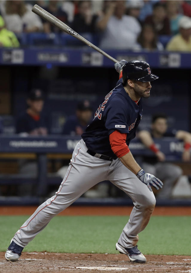 Boston Red Sox's J.D. Martinez lines an RBI-single off Tampa Bay Rays relief pitcher Wilmer Font during the sixth inning of a baseball game Friday, April 19, 2019, in St. Petersburg, Fla. Boston's Mookie Betts scored. (AP Photo/Chris O'Meara)