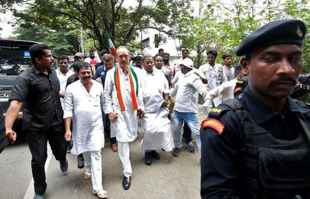 India's main opposition Congress party's leaders K. C. Venugopal (2-L), Ghulam Nabi Azad (C) and outgoing Chief Minister of the southern state of Karnataka Siddaramaiah lead a protest against India's ruling Bharatiya Janata Party (BJP) leader B.S. Yeddyurappa's swearing-in as Chief Minister of the southern state, in Bengaluru, India, May 18, 2018. REUTERS/Abhishek N. Chinnappa