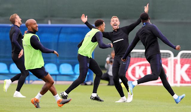 Ready to go: England's squad train ahead of their first World Cup semi final in 28 years. (PA)