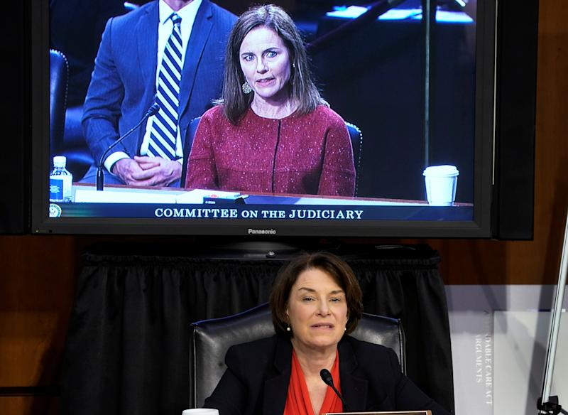 Amy Klobuchar, bottom, and Amy Coney Barrett