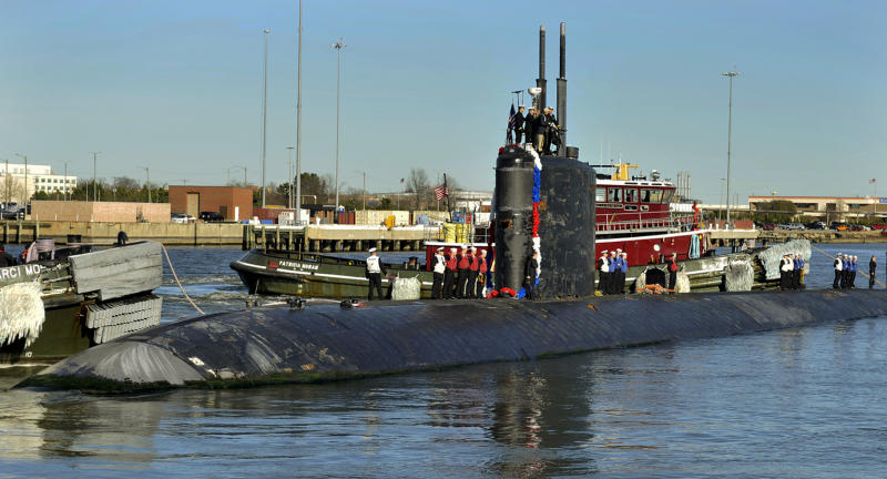In this Jan. 13, 2014 photo, the Los Angeles-class attack submarine USS Scranton returns to Naval Station Norfolk, Va., from a regularly scheduled deployment. Scientists at the Naval Submarine Medical Research Laboratory in Groton, Conn., concluded submarine sailors, who traditionally begin a new workday every 18 hours, show less fatigue on a 24-hour schedule. The first submarine to try the new schedule on a full deployment was the Scranton, led by Cmdr. Seth Burton, who said he found that the more consistent sleep pattern made up for any effects from working slightly longer shifts. (AP Photo/U.S. Navy photo, Shannon D. Barnwell)