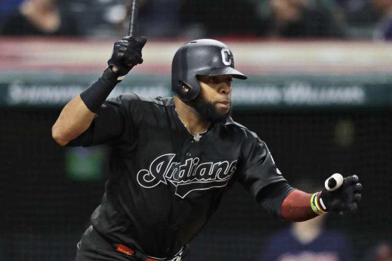 Cleveland Indians' Carlos Santana watches his single in the fifth inning in a baseball game against the Kansas City Royals, Friday, Aug. 23, 2019, in Cleveland. (AP Photo/Tony Dejak)