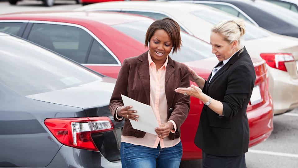 """""""Woman shopping for a new car, with a saleswoman."""