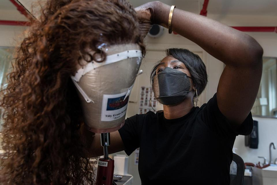 Hairdresser Akilah Abrams prepares a wig in the hair room on Sept. 21, 2021. <i>Moulin Rouge!</i> is her Broadway debut.