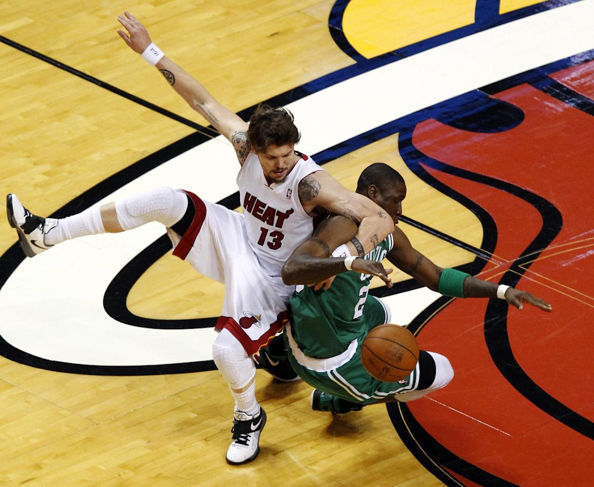 Miami Heat's Mike Miller (13) fouls Boston Celtics' Mickael Pietrus (28) during the first half of Game 5 in their NBA basketball Eastern Conference finals playoffs series, Tuesday, June 5, 2012, in Miami. (AP Photo/Wilfredo Lee)