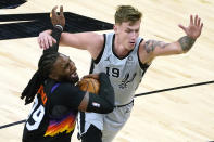 Phoenix Suns forward Jae Crowder gets fouled by San Antonio Spurs forward Luka Samanic (19) during the second half of an NBA basketball game Saturday, April 17, 2021, in Phoenix. (AP Photo/Rick Scuteri)