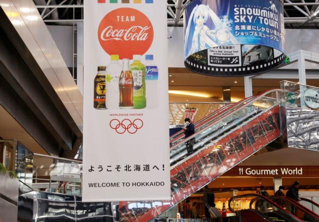 FILE PHOTO: A campaign banner for Tokyo 2020 Olympic Games of Coca-Cola, a Worldwide Olympic Partners, is displayed at New Chitose Airport in Chitose