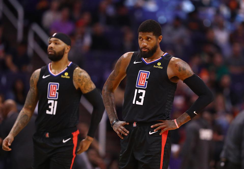 Feb 26, 2020; Phoenix, Arizona, USA; Los Angeles Clippers guard Paul George (13) and forward Marcus Morris Sr. (31) against the Phoenix Suns at Talking Stick Resort Arena. Mandatory Credit: Mark J. Rebilas-USA TODAY Sports
