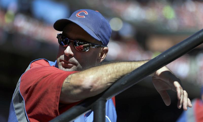 Chicago Cubs manager Dale Sveum watches from the dugout during the first inning of a baseball game against the St. Louis Cardinals, Sunday, Sept. 29, 2013, in St. Louis. (AP Photo/Jeff Roberson)