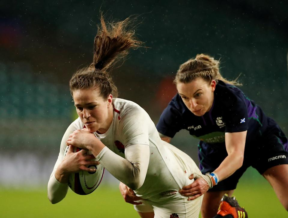 Rugby Union - Women's Six Nations Championship - England v Scotland - Twickenham Stadium, London, Britain - March 16, 2019   England's Emily Scarratt in action with Scotland's Chloe Rollie as she scores a try   Action Images/Andrew Boyers