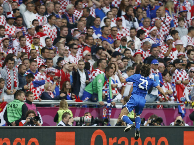Italy's Andrea Pirlo celebrates after he scored during the Euro 2012 soccer championship Group C match between Italy and Croatia in Poznan, Poland, Thursday, June 14, 2012. (AP Photo/Jon Super)