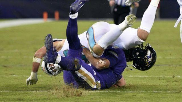 Flacco gets monstered. Pic: AP