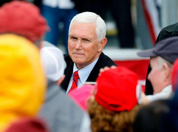 PHOTO: Vice President Mike Pence greets supporters after his 'Make America Great Again!' campaign event at Oakland County International Airport in Waterford, Oct. 22, 2020. (Jeff Kowalsky/AFP via Getty Images)